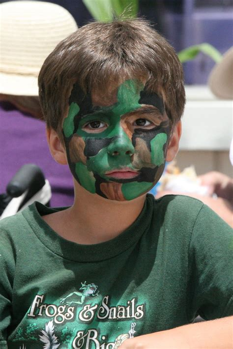 Camo Boy | A boy with this face painted in jungle camo at